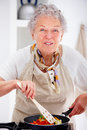 Grandma preparing a hearty meal Royalty Free Stock Image