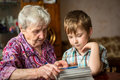 Grandma shows grandson photo album. Family. Royalty Free Stock Photo