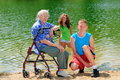 Grandma and teens by lake Royalty Free Stock Images