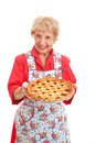 Grandmas homemade cherry pie sweet grandmother holding a delicious retro look isolated on white Stock Image