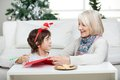 Grandmother assisting boy in writing letter to santa claus during christmas at home Royalty Free Stock Photo