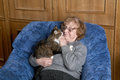 The grandmother with a cat in house Royalty Free Stock Photography