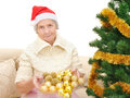 Grandmother decorates the christmas tree toys Stock Photo