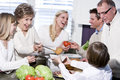 Grandmother with family laughing in kitchen Royalty Free Stock Image