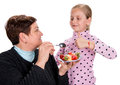 Grandmother feeds strawberry to her granddaughter on a white background Stock Photography