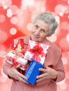 Grandmother with gifts looking at the camera Royalty Free Stock Images