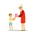 Grandmother giving gift box to her happy grandson colorful characters vector Illustration