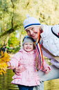Grandmother with the grand daughter in park Stock Photography