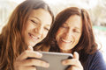Grandmother and grandaughter with mobile phone Royalty Free Stock Photo