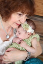 Grandmother and grandaughter with a three month old baby girl Stock Image