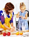 Grandmother and grandchild baking cookies granddaughter Royalty Free Stock Photo