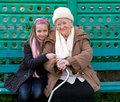Grandmother and grandchild sitting on the bench Stock Photography