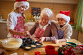 Grandmother and grandchildren preparing cookies -Family time Royalty Free Stock Photo