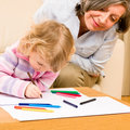 Grandmother and granddaughter drawing at home Stock Image