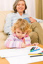 Grandmother and granddaughter drawing at home Royalty Free Stock Photos