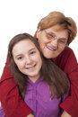 Grandmother and granddaughter hugging isolated on white background Stock Photography