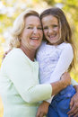 Grandmother and granddaughter outdoors and smiling Royalty Free Stock Photography