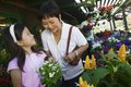 Grandmother and granddaughter in plant nursery Stock Images