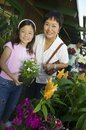 Grandmother and granddaughter in plant nursery portrait Royalty Free Stock Photography