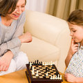 Grandmother and granddaughter play chess together Stock Image