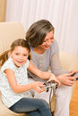 Grandmother and granddaughter play computer game Royalty Free Stock Photo