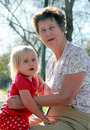Grandmother and granddaughter playing together outdoors Royalty Free Stock Image