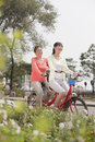 Grandmother and granddaughter riding tandem bicycle, Beijing Royalty Free Stock Photo