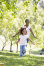 Grandmother and granddaughter running in park and Royalty Free Stock Images