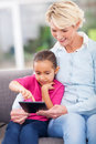 Grandmother granddaughter tablet happy and using computer at home Royalty Free Stock Photography