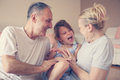 Grandmother and grandfather with their granddaughter. Royalty Free Stock Photo