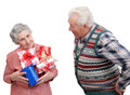 Grandmother and grandfather together with gifts on white background Stock Image