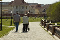 Grandmother and grandfather are walking with her grandson. Royalty Free Stock Photo