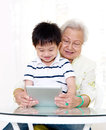 Grandmother and grandson asian using tablet computer Royalty Free Stock Photography