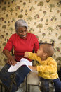 Grandmother with grandson coloring. Stock Photos