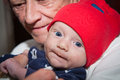 Grandmother and grandson holding infant smiling Stock Images