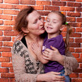 Grandmother and her grand daughter Stock Photos
