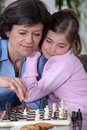A grandmother and her granddaughter playing chess Royalty Free Stock Photos