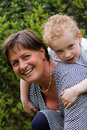 Grandmother with her grandson Stock Images