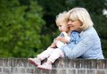 Grandmother holding cute baby girl portrait of a Stock Photography