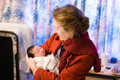 Grandmother holds her newborn granddaughter first time hospital Stock Images