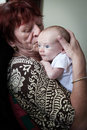Grandmother kissing newborn grandson cute Royalty Free Stock Photography