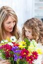 Grandmother with a little girl with flowers Royalty Free Stock Photo