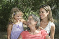 Grandmother mother and girl in garden portrait of smiling daughter the Royalty Free Stock Images