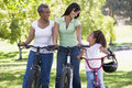 Grandmother mother and granddaughter bike riding Stock Images