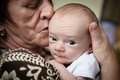 Grandmother and newborn grandson kissing cute Royalty Free Stock Images
