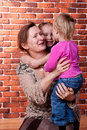 Grandmother playing with her grandchildren Royalty Free Stock Photo