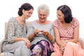 Grandmother teach granddaughters to knit Stock Photos