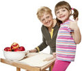 Grandmother teaching her granddaughter cooking Royalty Free Stock Photography