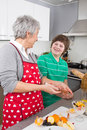 Grandmother teaching young boy to make dessert family life at hom making with home in the kitchen Royalty Free Stock Photography