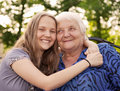 Grandmother and teenager girl granddaughter Stock Images